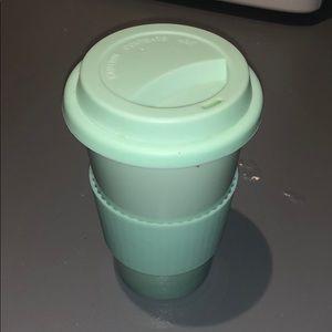 Mint green ceramic travel cup